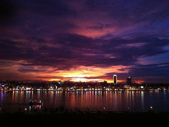 Sunset view from Yellow Tower over Phnom Penh city at 7PM