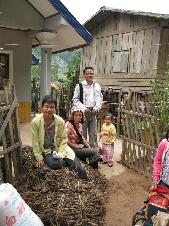 Khmu kid with Erpa Akha lady looking on