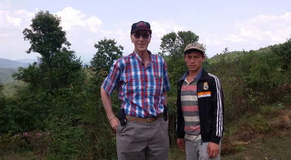 My associate Mr. Xiong a Lao Hmong tea farmer providing me with Pou San Tea..from his forest tea planting.